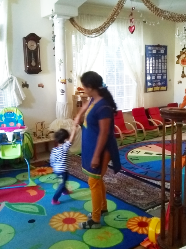 Daycare helper dancing to Bollywood with child