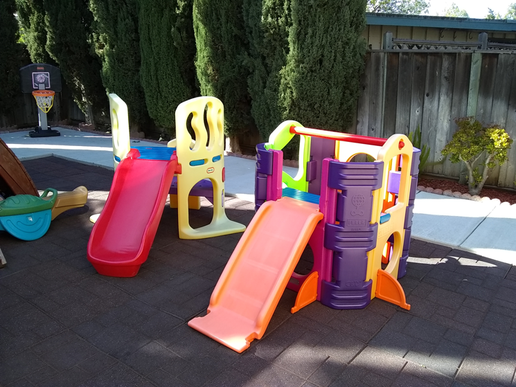 Small plastic slides in outside play area